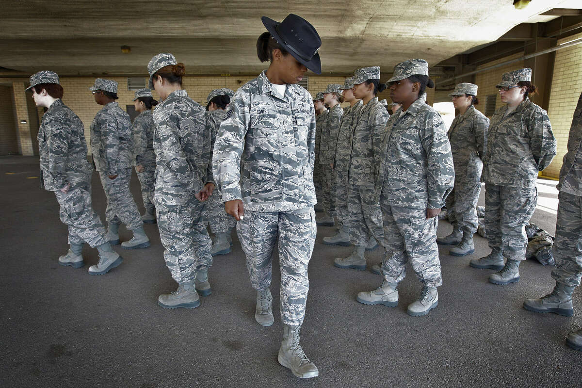 Staff Sgt. Katrevious Swift, 31 (center), works on drills with a flight of Air Force basic trainees at Joint BaseSan Antonio-Lackland. Swift says it's a job she has dreamed of having since her own basic training in 2005.