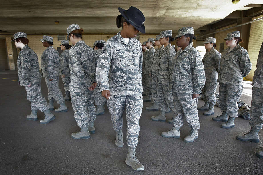 Staff Sgt. Katrevious Swift, 31 (center), works on drills with a flight of Air Force basic trainees at Joint BaseSan Antonio-Lackland. Swift says it's a job she has dreamed of having since her own basic training in 2005. Photo: Photos By Kin Man Hui / San Antonio Express-News