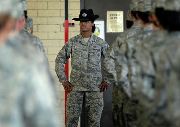 Staff Sgt. Katrenvious Swift (left), a military training instructor, works on drills with a flight of Air Force basic trainees at Joint Base San Antonio - Lackland on Friday, Feb. 8, 2013. Swift is one of 53 female instructors in the Air Force. As part of the recommendations from an investigation stemming from  numerous cases of sexual assault, new procedures and implementations have been started or put into place at Lackland. One of the new policies include having one female trainer on each team like Swift. Photo: Kin Man Hui, San Antonio Express-News / © 2012 San Antonio Express-News