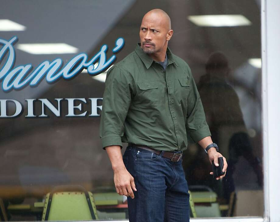 "In ""Snitch,"" Dwayne Johnson plays a dad who takes matters into his own hands in an undercover effort to clear his son of a false drug charge. The movie opens Friday at Bay Area theaters. Photo: Summit Entertainment"
