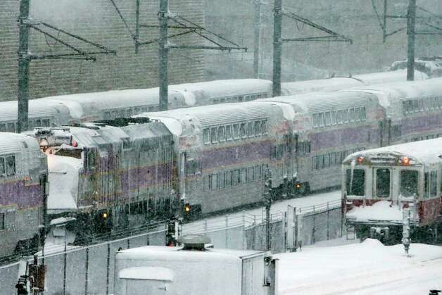 Massachusetts Bay Transportation Authority trains sit idle early Saturday, Feb. 9, 2013 in Boston due to high winds and the nearly two-feet of snow that fell in the area overnight. Photo: Gene J. Puskar