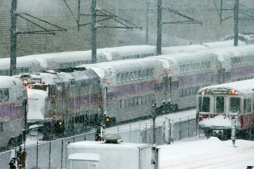 Massachusetts Bay Transportation Authority trains sit idle early Saturday, Feb. 9, 2013 in Boston du