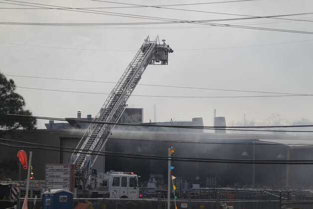 Firefighters respond to an explosion at the Air Liquide plant in La Porte near Houston. (Johnny Hanson/Chronicle)