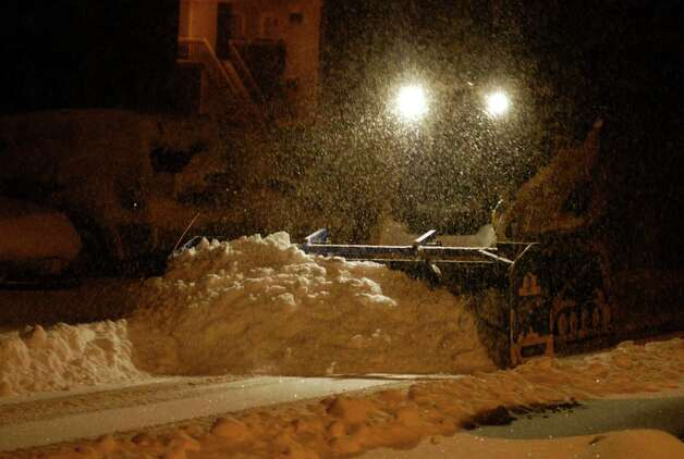 State, town and private snow plows work around the clock Friday night to keep up with the swirling snowfall in the Greater New Milford area during the peak hours of Storm Nemo, or Charlotte, depending on one's preference for names. Feb. 9, 2013 Photo: Norm Cummings / The News-Times