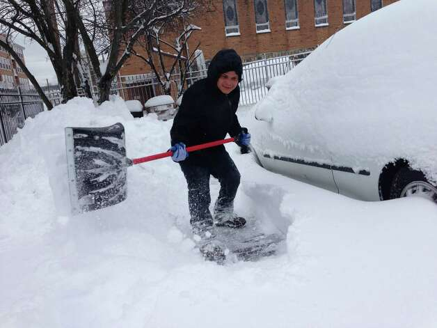 Danny Escobar digs out his car in Stamford. Photo: Contributed