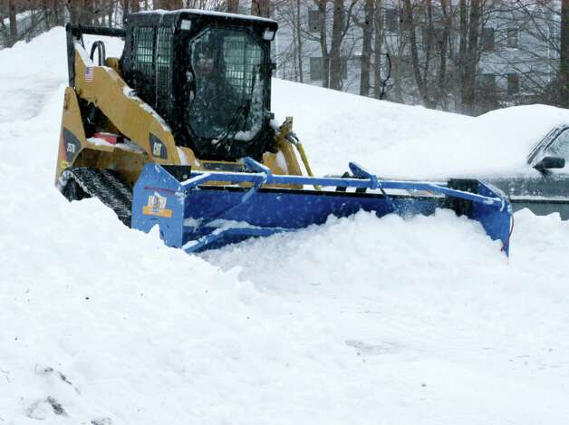 Snow plows have plenty of business in the Greater New Milford area during the aftermath of Storm Nemo, or Charlotte, depending on one's preference for names. Feb. 9, 2013 Photo: Norm Cummings / The News-Times