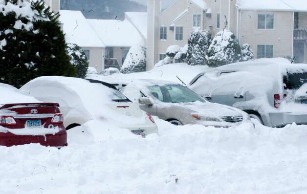 Countless vehicles find themselves with plenty of digging out to day Saturday morning after the worst of Storm Nemo, or Charlotte, had passed through the Greater New Milford area. Feb. 9, 2013 Photo: Norm Cummings / The News-Times