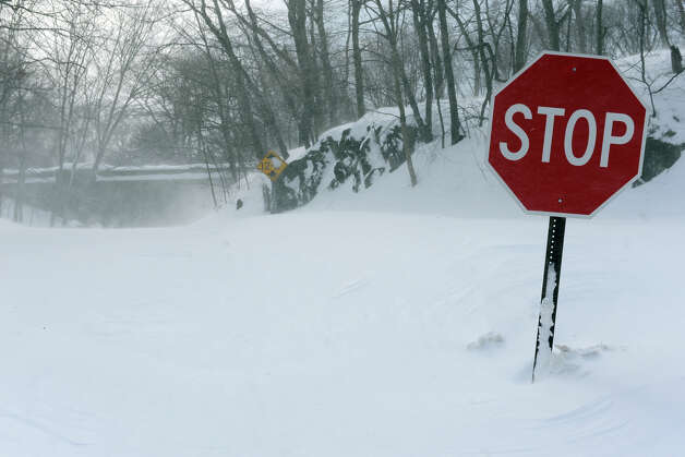 Drifting snow blocks the intersection of Cutsping and Pumpkin Ground Roads, in Stratford, Conn., Feb. 9th, 2013. Photo: Ned Gerard