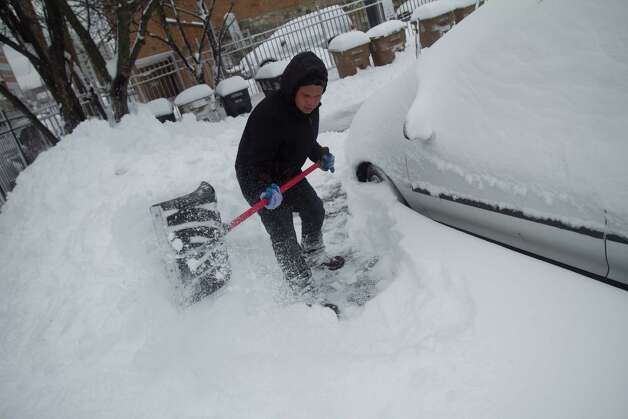 Danny Escobar clears a path in a parking lot on Stamford's West Side dig out from the blizzard on Saturday, Feb. 9, 2013. Photo: Chris Preovolos / Stamford Advocate