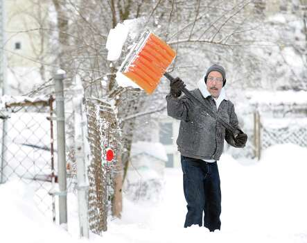 Luis Herrera clears snow from his South Water Street home in Byram during the aftermath of the blizzard that hit Greenwich, Conn., Saturday morning, Feb. 9, 2013. Photo: Bob Luckey / Greenwich Time