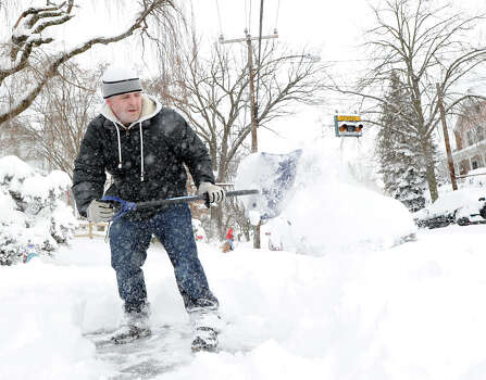 A man shovels snow on Mead Avenue during the aftermath of the blizzard that hit Greenwich, Conn., Saturday morning, Feb. 9, 2013. Photo: Bob Luckey / Greenwich Time