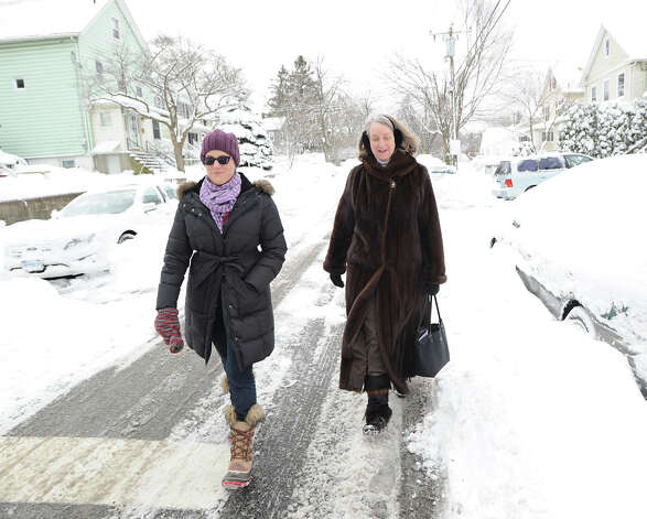 Dana Myers, left, and Kathy Anderson, both of Byram, walk on Mead Avenue during the aftermath of the blizzard that hit Greenwich, Conn., Saturday morning, Feb. 9, 2013. Photo: Bob Luckey / Greenwich Time