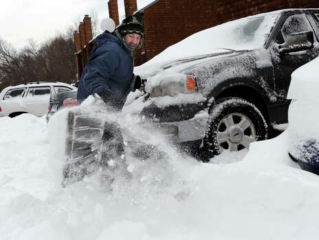 Richard Effinger, 43, of Danbury, digs his truck out from the snow Saturday morning, February 9, 2013. Photo: Carol Kaliff / The News-Times