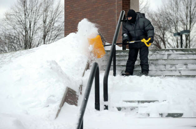 The steps of the Danbury Superior Court is shovelled Saturday morning, Feb. 9, 2013, after a heavy snow fall. Photo: Carol Kaliff / The News-Times