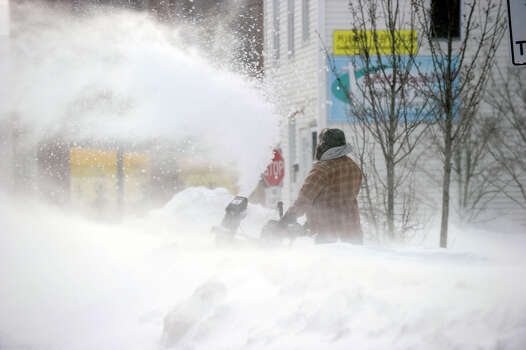 Gusts of wind make snowblowing difficult Saturday morning, Feb. 9, 2013, on Maple Avenue in Danbury, Conn. Almost two feet of snow was dumped on the area by a blizzard Friday and early Saturday. Photo: Carol Kaliff / The News-Times