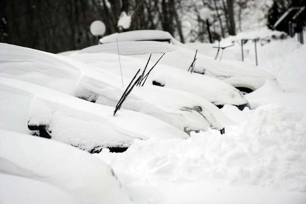 In a scene repeated all over the area this morning, cars are buried in snow at the Sheperd Hill Condominiums in Danbury early Saturday morning, Feb. 9, 2013. A blizzard Friday into Saturday dumped almost two feet of snow. Photo: Carol Kaliff / The News-Times