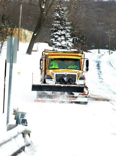 A City plow truck clears Kenosia Avenue in Danbury Friday, Feb. 8, 2013.