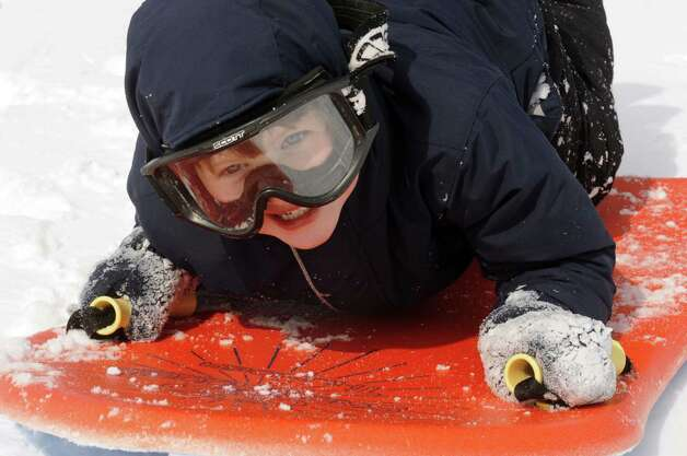 Here are scenes from our last bout with a winter storm, dubbed 'Nemo' by the Weather Channel: Five-year-old Ewan MacNaughton of Albany enjoys a sled ride at Capital Hills Golf Course on Saturday Feb. 9, 2013 in Albany, N.Y. .(Michael P. Farrell/Times Union) Photo: Michael P. Farrell