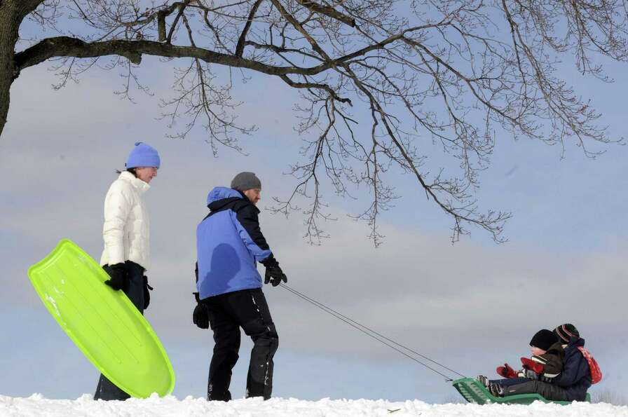 Megan and Dave Dawson take their children Jack, 1-years-old, and Noah, 4-years-old, sledding at Capi