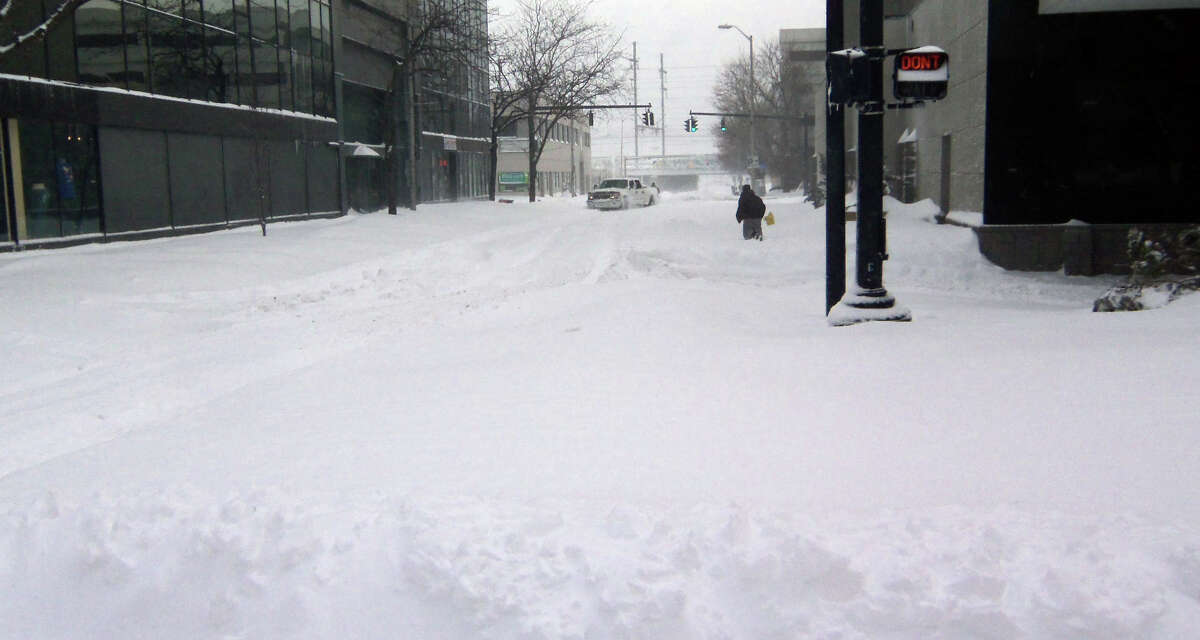 Looking east along Fairfield Avenue from Main Street in downtown Bridgeport Saturday morning. The four-wheel-drive pickup truck in the background was stuck in a drift.