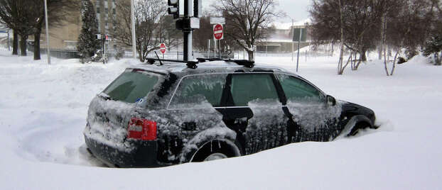 This all-wheel-drive Audi station wagon met its match on the corner of Lafayette and John streets. This photo was taken at about 9 a.m. Saturday morning. Photo: John Burgeson / Connecticut Post