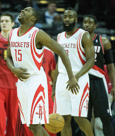 Rockets point guard Toney Douglas grimaces as he leaves the court with a left hip pointer. Photo: Smiley N. Pool, Houston Chronicle / © 2013  Houston Chronicle