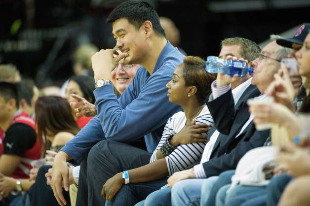 Former Rockets center Yao Ming watches from the front row. Photo: Smiley N. Pool, Houston Chronicle / © 2013  Houston Chronicle