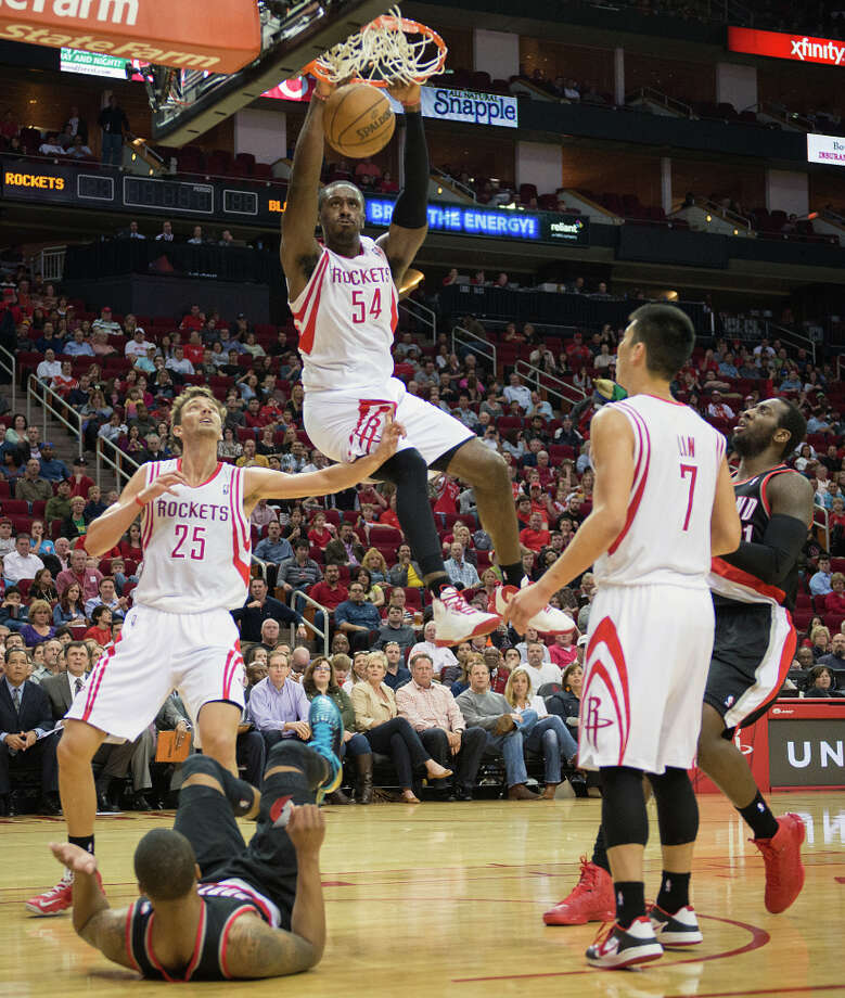 Rockets power forward Patrick Patterson (54) goes up for a dunk. Photo: Smiley N. Pool, Houston Chronicle / © 2013  Houston Chronicle