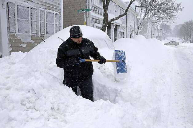 John Silver shovels between buried cars in front of his home on Third street in the South Boston neighborhood of Boston, Saturday, Feb. 9, 2013. A behemoth storm packing hurricane-force wind gusts and blizzard conditions swept through the Northeast on Saturday, dumping more than 2 feet of snow on New England and knocking out power to 650,000 homes and businesses.  Photo: Gene J. Puskar, Associated Press
