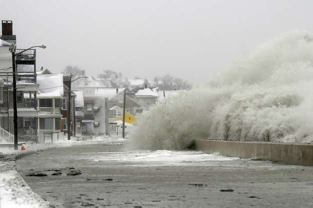 Water from the ocean crashes over the sea wall along Winthrop Shore Drive on February 9, 2013 in Winthrop, Massachusetts.  The powerful storm has knocked out power to 650,000 and dumped more than two feet of snow in parts of New England. Photo: Darren McCollester, Getty Images