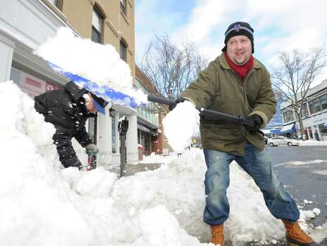 Nick Stroz, a Greenwich Avenue resident, clears snow from a sidewalk on the Avenue during the aftermath of the blizzard that hit Greenwich, Conn., Saturday morning, Feb. 9, 2013. Stroz said he was just trying to clear a path for others and to be helpful during the storm. Photo: Bob Luckey / Greenwich Time