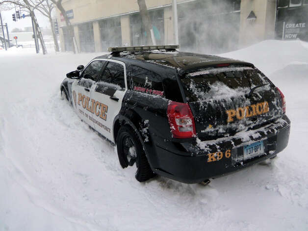 Things got so bad in downtown Bridgeport, even a police car was stranded on John Street. Photo: John Burgeson / Connecticut Post