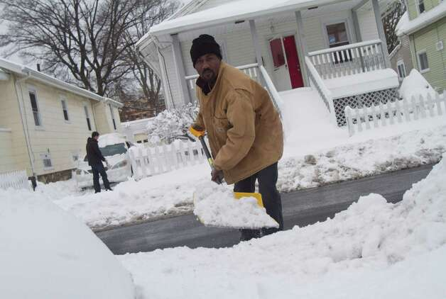 Nigel Pryce, a resident of Stamford's West Side digs out from the blizzard on Saturday, Feb. 9, 2013. Photo: Chris Preovolos / Stamford Advocate