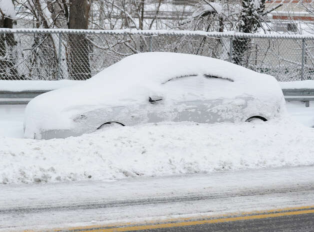 A car covered with snow on Byram Road during the aftermath of the blizzard that hit Greenwich, Conn., Saturday morning, Feb. 9, 2013. Photo: Bob Luckey / Greenwich Time