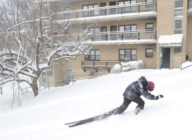 Daniel Estrella, 9, struggles to pull his sled up a hill during the aftermath of the blizzard at the Armstrong Court Public Housing Complex, Greenwich, Conn., Saturday morning, Feb. 9, 2013. Photo: Bob Luckey / Greenwich Time