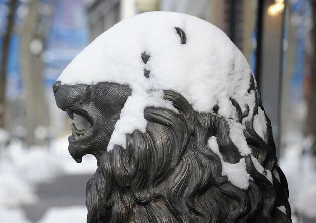 A snow-covered statue of a lion in front of Betteridge Jewelers on Greenwich Avenue during the aftermath of the blizzard that hit Greenwich, Conn., Saturday morning, Feb. 9, 2013. Photo: Bob Luckey / Greenwich Time