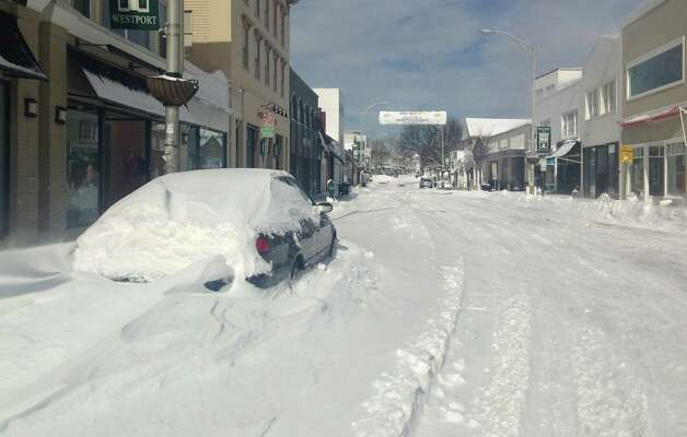 A car was marooned in a Main Street snow bank Saturday, but not much other activity was in evidence after a blizzard dumped 2 to 3 feet of snow on the town.  WESTPORT NEWS, CT 2/9/13 Photo: Paul Schott / Westport News