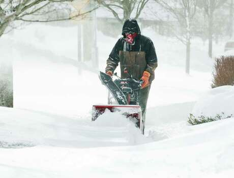 Cliff Ritter of Woodbury cuts through the drifts in front of Copps Hill Commons in Ridgefield, after the snowstorm moved out. Saturday, Feb. 9, 2013 Photo: Scott Mullin / The News-Times Freelance