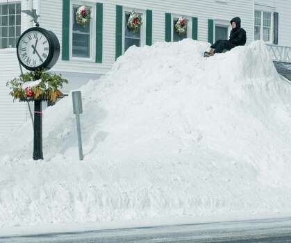 Gabe Altopp, 15 of Ridgefield, sits on top of a plowed pile of snow on Main Street in Ridgefield after the snowstorm had passed. Saturday, Feb. 9, 2013 Photo: Scott Mullin / The News-Times Freelance