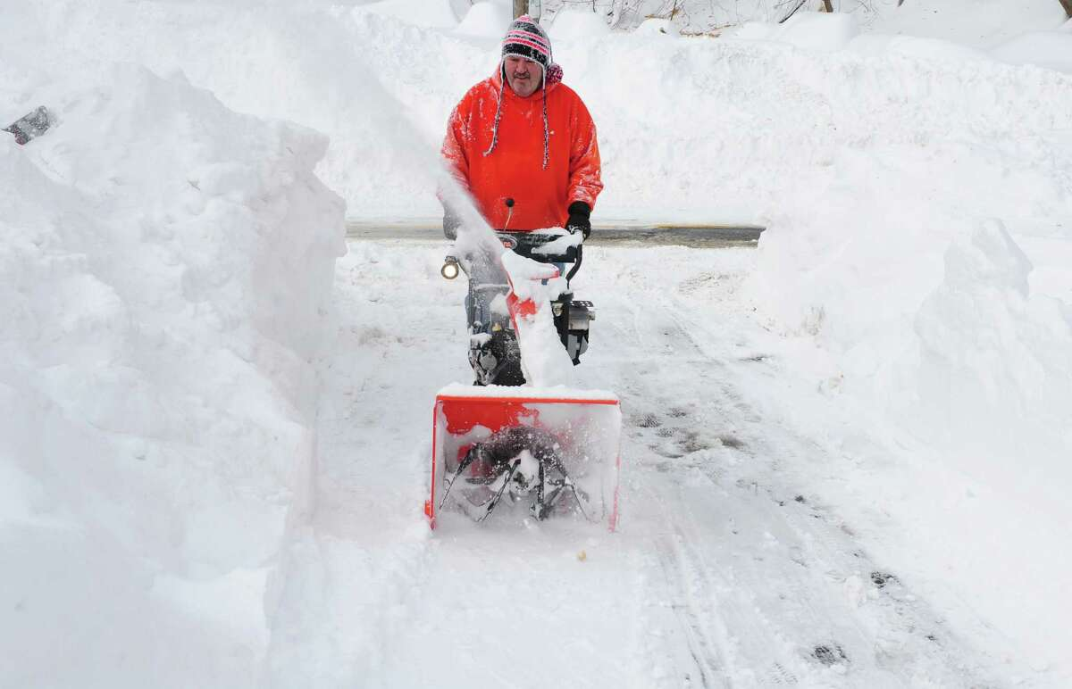 Dave Stec uses a snowblower to clear his driveway in Derby, Conn. as residents face massive snow removal Saturday, Feb. 9, 2013 following a severe blizzard that dumped up to three feet of snow across the state.