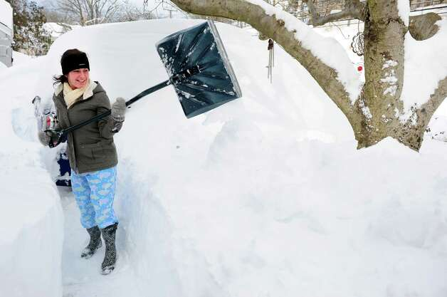 Chloe Campoli shovels a path from her house in Derby, Conn. as residents face massive snow removal Saturday, Feb. 9, 2013 following a severe blizzard that dumped up to three feet of snow across the state. Photo: Autumn Driscoll