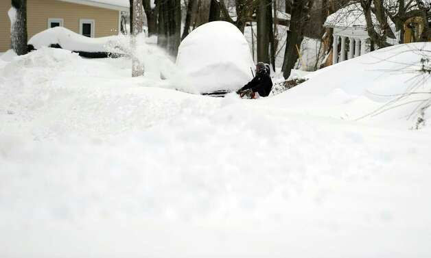Residents in Derby, Conn. face massive snow removal Saturday, Feb. 9, 2013 following a severe blizzard that dumped up to three feet of snow across the state. Photo: Autumn Driscoll