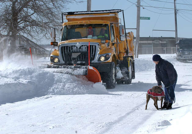 A snow plow works its way along Beach Street after a blizzard pounded the region in West Haven, Conn. on Saturday February 9, 2013. Side streets were still impassable and had not been plowed yet as of Saturda afternoon. Photo: Christian Abraham / Connecticut Post