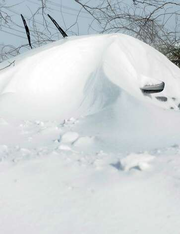 Cars were buried under snowdrifts in Fairfield, Conn. on Saturday, Feb. 9, 2013. Southwestern Connecticut was hit by a howling blizzard that dumped over two feet of snow on the area. Photo: Cathy Zuraw / Connecticut Post