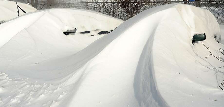Cars were buried under snowdrifts in Fairfield, Conn. on Saturday, Feb. 9, 2013. Southwestern Connecticut was hit by a howling blizzard that dumped over two feet of snow on the area. Photo: Cathy Zuraw