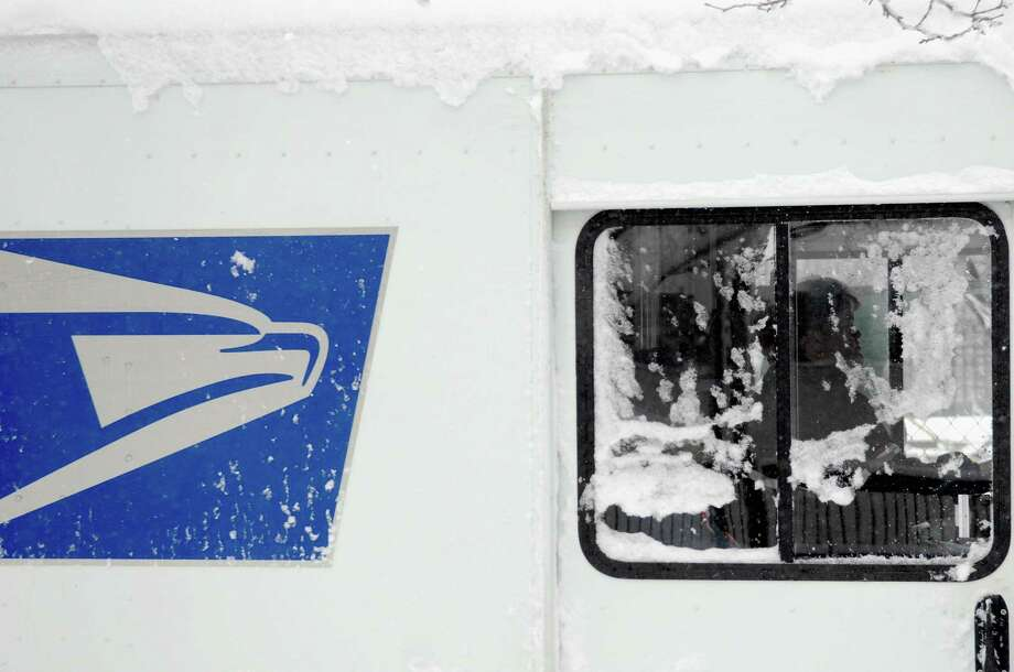 The Postal Service says the volume of package deliveries is expected to increase by 12 percent this holiday season. Photo: Michael Bocchieri / Getty Images / 2013 Getty Images