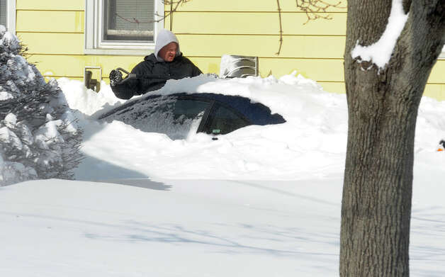 Residents dig out with shovels and snowblowers after a blizzard pounded the region in West Haven, Conn. on Saturday February 9, 2013. Photo: Christian Abraham / Connecticut Post