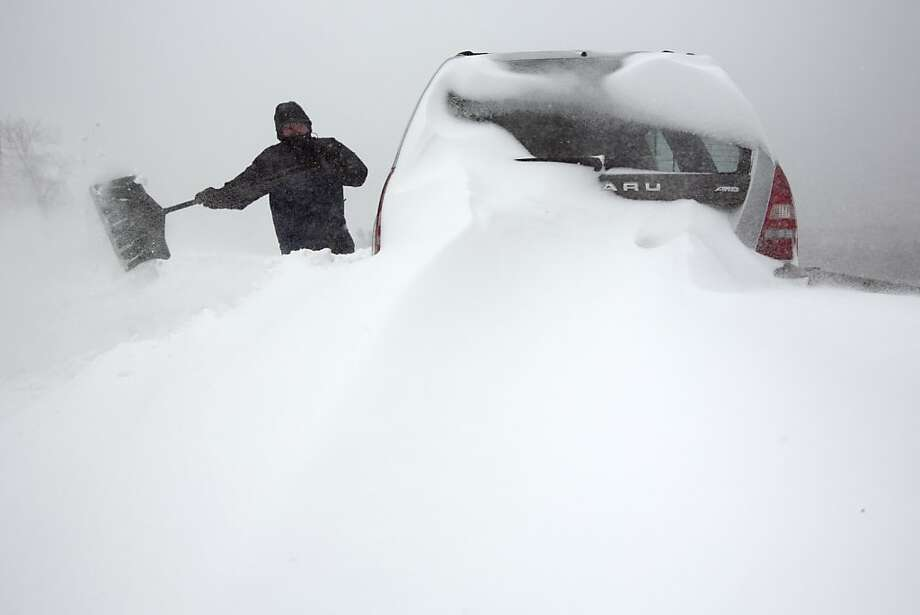 Steve Hull digs out his car after it was covered by drifting snow in Portland, Maine on Saturday, Feb. 9, 2013. A behemoth storm packing hurricane-force wind gusts and blizzard conditions swept through the Northeast overnight. Photo: Robert F. Bukaty, Associated Press