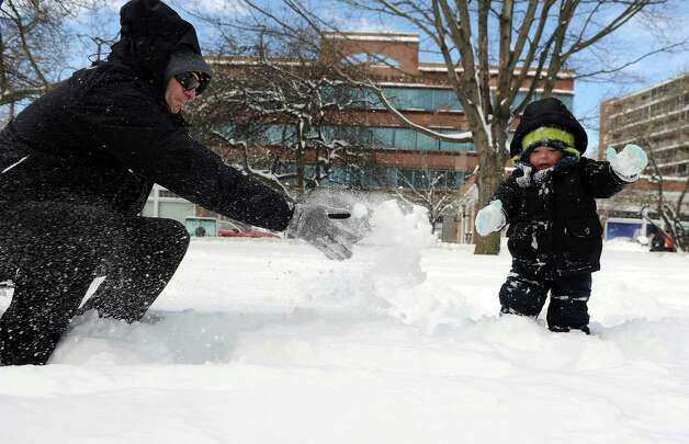 Warren Bradley plays with his son, Henry, 2, in Latham Park in Stamford, Conn., on Saturday, February 9, 2013. Photo: Lindsay Perry / Stamford Advocate