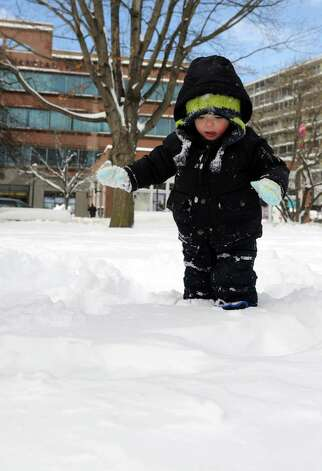 Henry Bradley, 2, plays in Latham Park in Stamford, Conn., on Saturday, February 9, 2013. Photo: Lindsay Perry / Stamford Advocate